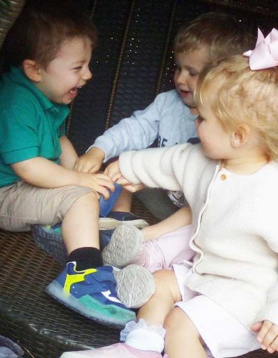Oakwood Community Pre-school | Gallery | Lots of children in the next outside playing