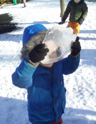 Oakwood Community Pre-school | Gallery | Child showing staff a large piece of ice