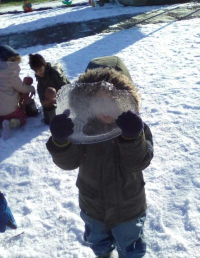 Oakwood Community Pre-school | Gallery | Another child showing staff a large piece of ice