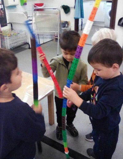 Oakwood Community Pre-school | Gallery | Children building tallest single multilink tower