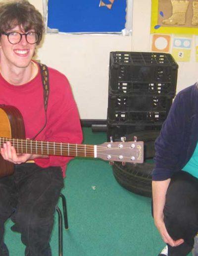 Oakwood Community Pre-school | Gallery | Staff playing guitar