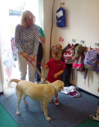 Oakwood Community Pre-school | Gallery | Child being introduced to Rosie the dog