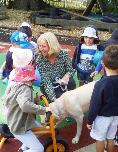Oakwood Community Pre-school | Gallery | Children meeting Rosie the dog