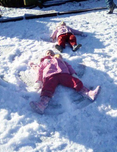Oakwood Community Pre-school | Gallery | Children making snow angels in the snow