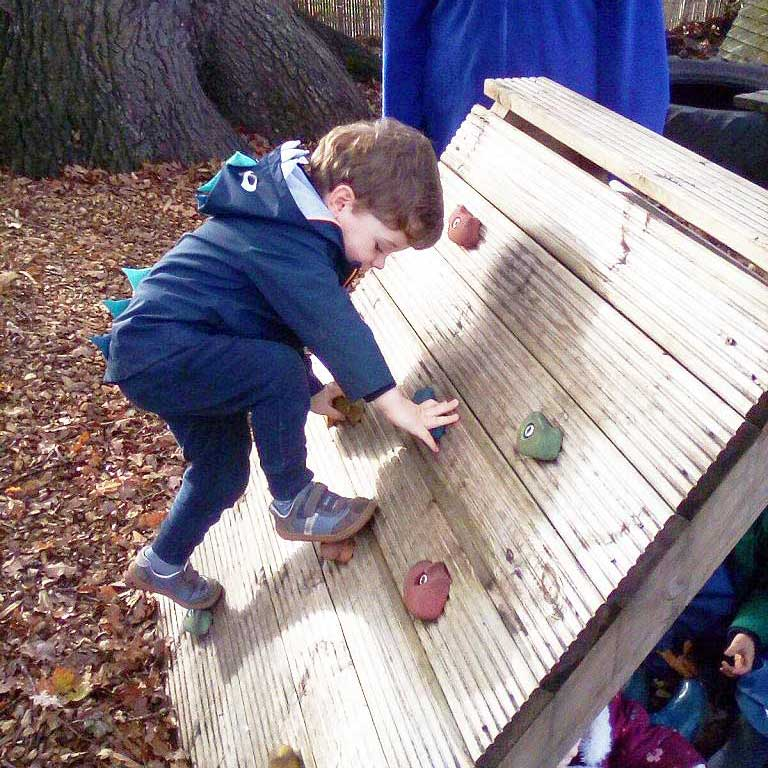 Oakwood Community Pre-school | Gallery | Children using tubes indoors